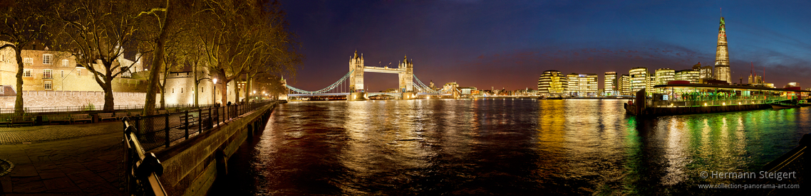 View of the Thames with the Tower of London on the left and the Tower Bridge in the background